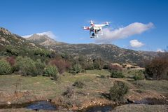 Drone flying over the ground while taking pictures with its built-in camera royalty free stock photography