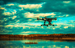 Drone flying over lake Stock Photography