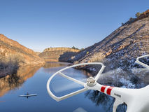 Drone flying over lake with canoe. Quadcopter drone flying over lake with a canoe - Horsetooth Reservoir near Fort Collins, Colorado royalty free stock images