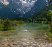 Drone flying over mountain lake. Alps, Italy. Drone flying over mountain lake. Alps, Italy Royalty Free Stock Photos