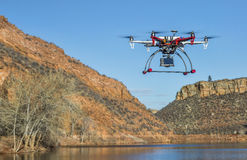 Drone flying over mountain lake Stock Photo