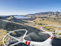 Drone flying over mountain valley Stock Photo