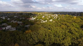 Drone flying over the park for which the residential area stock footage