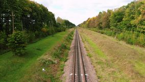 Drone flying over railroad tracks. Empty railway road at summer season. Aerial view, stock video