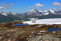 Drone flying over snow mountains. Norway Stock Photo