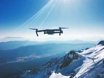 Drone flying over snowy mountains
