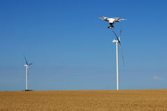 Free Drone Flying Over Wheat Field With Wind Turbine Stock Photos - 90706213