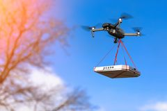 DRONE IS FLYING WITH A PIZZA royalty free stock image