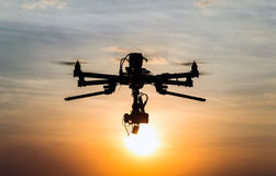 Drone flying. Professional drone flying in the sunset stock images