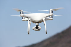 Drone flying in the sky Stock Photo