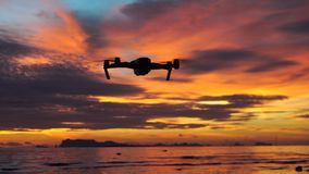 Drone flying at sunset above the sea stock video