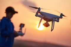 Drone flying at sunset Stock Images