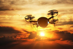 Drone flying at sunset. Sun shining on dramatic sky. Royalty Free Stock Image