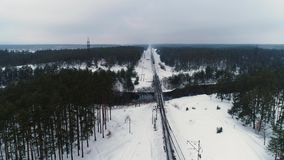 Aerial drone footage. Drone following train in winter forest. Drone following train in winter forest stock video