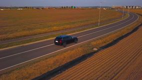 Drone follows a car from right in 4K stock video