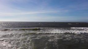 Drone follows a kite boarder in open ocean
