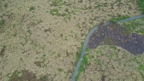 Drone Follows Meandering Mountain Road among Jungle stock video