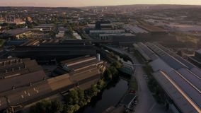 SHEFFIELD, UK - 13TH AUGUST 2019: Aerial footage of a reveal of Sheffield City, South Yorkshire, UK at Sunset. Drone footage captured above the city of Sheffield stock video