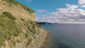 Cliff beach drone flight stock video footage