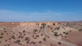 Drone footage flying over a kasbah in Morocco stock video footage