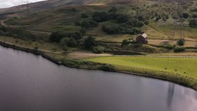 Aerial 180 degree Pan of the Peak District National Park. Drone footage flying through the peak district looking at streams and rivers that feed into reservoirs stock video