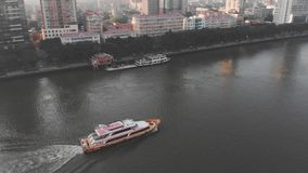 Drone footage Guangzhou, China. On the river float boat stock footage