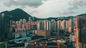 Footage of Hong Kong and Kowloon cityscape  view fron sky. Drone footage of Hong Kong and Kowloon city from the sky stock video