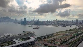 Footage of Hong Kong and Kowloon cityscape  view fron sky. Drone footage of Hong Kong and Kowloon city from the sky stock footage