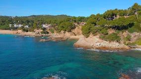 Drone footage over the Costa Brava coastal near the small village Sant Antoni de Calonge of Spain. Torre Valentina bays stock video