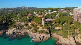 Drone footage over the Costa Brava coastal near the small village Sant Antoni de Calonge of Spain. Torre Valentina bays stock footage