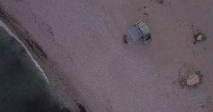 Drone footage of people and camping van stock video footage