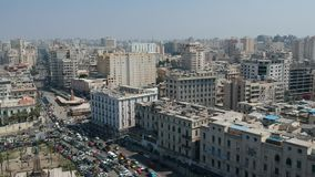 Drone footage of street with many cars in Alexandria, Egypt stock video