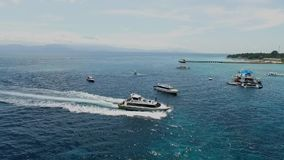 Drone footage of a speed boat or yacht sailing in the Nusa Penida sea Bali Indonesia stock video