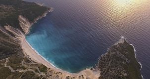 Drone footage of sunset above famous Myrtos beach in Kefalonia stock video