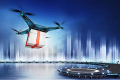 Drone with gift box at flight over heliport Royalty Free Stock Photo