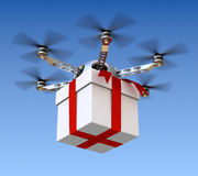 Drone with the gift. Drone with the white gift box over sky background Stock Photos