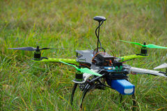 Drone with green propeller on green grass Royalty Free Stock Photography