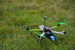 Drone with green propeller on green grass Stock Photo