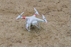 Drone on the ground. A modern drone in white is placed on the ground royalty free stock photos