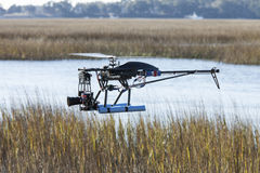 Drone helicopter flying over water Royalty Free Stock Images
