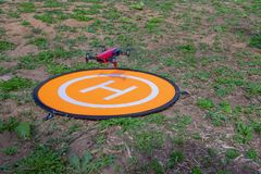 Drone on the heliport. Drone flying at the heliport stock image