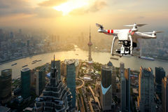 Drone with high resolution digital camera flying over Shanghai. City with Eiffel tower at sunset in Shanghai, China Royalty Free Stock Photos