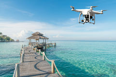 Drone with high resolution digital camera flying over tropical s Royalty Free Stock Image