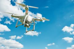 Drone hovering in blue sky Royalty Free Stock Photo
