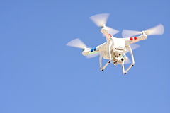 Drone Hovers Isolated Against Blue Sky Stock Photography