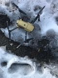 A drone on ice. A drone left on snow and ready to take Royalty Free Stock Image