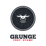 Drone icon. Quadrocopter symbol. Grunge post stamp. Circle banner or label. Drone icon. Quadrocopter with remote control symbol. Dirty textured web button Stock Images