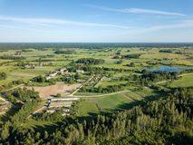 Drone image. aerial view of rural area with fields and forests. In cloudy spring day. latvia stock photography