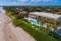 Aerial beach scene Boynton Beach Florida USA. Drone image of Boynton Beach FL USA beachfront mansions and palm trees Royalty Free Stock Images