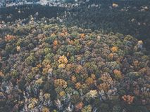 Drone image of a multicolored forest in the Southeastern United States with fall foliage. This was shot in rural Alabama with rolling hills stock photo